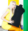 Bright portrait of beautiful blonde female with black dummy