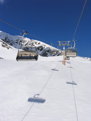 Chair lift in mountains