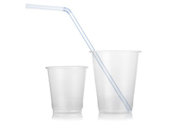 Two empty disposable plastic glass and straw isolated on white