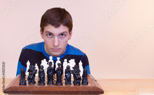 Young man playing chess