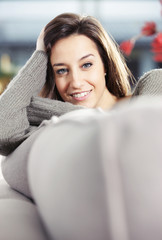 Portrait of a beautiful young woman on couch