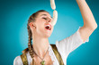 Junge Frau mit Weisswurst im Dirndl
