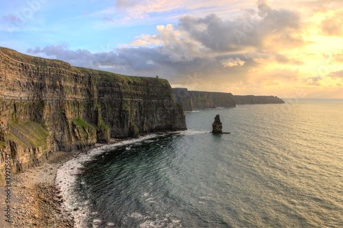 Breathtaking views of the Cliffs of Moher at sunset in Ireland.