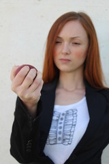 Pretty redhead woman squeezing stress ball