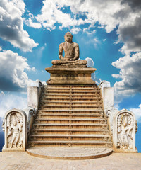 statue of a meditating Buddha against the sky. A collage of many