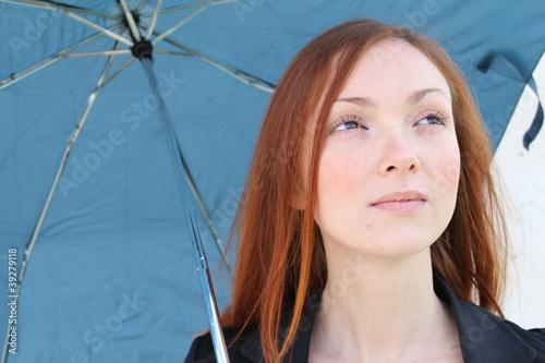 Pretty woman with an umbrella