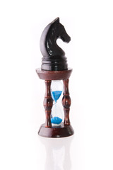 Black chess horse with sand-clock