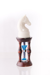 White chess horse with sand-clock