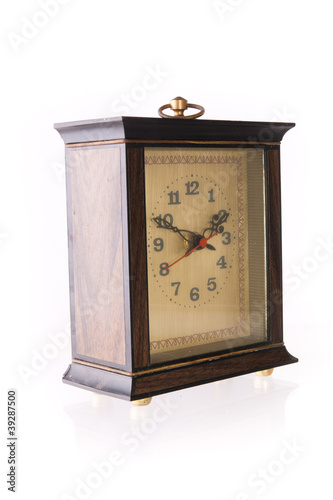 Old-fashion table clock made of wood