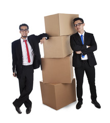Businessmen with stack of boxes