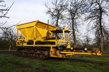 Big yellow machine - used for laying drainage stone