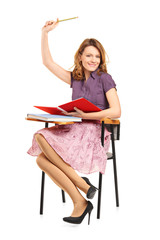 Female student sitting on a chair