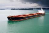 Bulk transport carrier under stormy sky