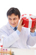 Happy medical doctor shaking present box