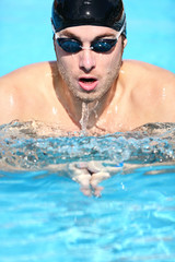 Swimmer - man swimming breaststroke