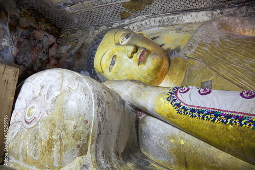 the reclining buddha statue in dambulla cave, sri lanka