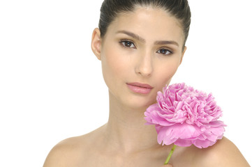 beautiful young woman with health skin and flower