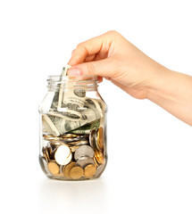 Glass bank for tips with money and hand