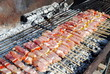 raw pork kabobs grill on skewers on a barbecue