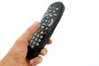 man hand holds a remote controller, isolated on white background