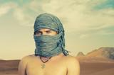 Brutal man in desert poster