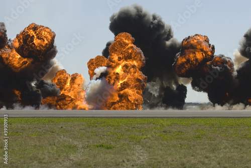 Multiple large explosions on airport runway