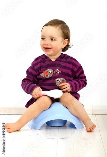 Leinwanddruck Bild Kleinkind auf einem Töpfchen