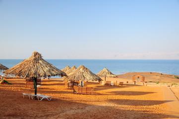 cane umbrellas on beach in Jordan
