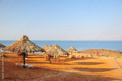 cane umbrellas on beach in Jordan
