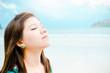 Attractive Asian woman enjoy on the beach