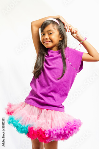 cute ethnic girl with tutu skirt portrait