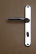 Türklinke an einer Hoteltür mit Schlüsselloch