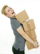 Woman with many packets grooving as a parcel service