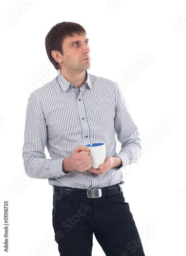Business man having cup of tea over white background