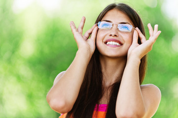 young woman glasses smiling