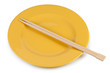 Yellow plate with chopsticks