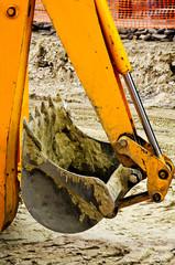 Yellow backhoe claw bucket