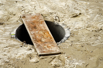 Unsecured sewer manhole