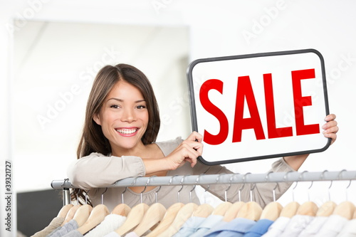Shop owner sale sign