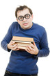 Student in glasses carefully pressed to his breast a book