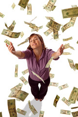 Raining money falling from sky on woman