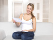 Young woman looking at her mail / letters