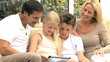 Young Family with Wireless Tablet in Home Setting