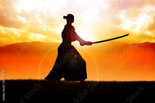 Fotobehang Vechtsport Silhouette of a samurai posing during sunset