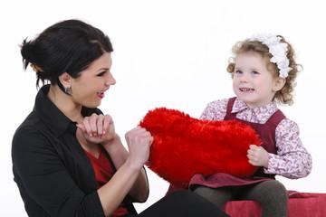 beautiful mother with her daughter studio shoot
