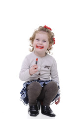 little girl playing with her mother makeup