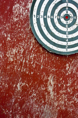 Dart hitting a target on red