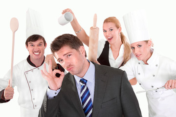 Restaurant manager with staff in the back