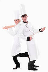 Two chefs with kitchen utensils