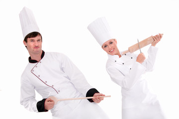 Two chefs playing kitchen utensils